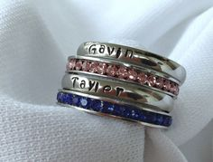 I'd love to have the ss ones with my kids' names.  https://www.etsy.com/listing/187437819/3mm-stackable-stainless-steel-stamped