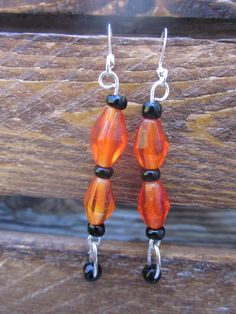 Halloween black and orange earrings with black dangle. $12.00, via Etsy.