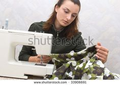stock photo : Hand sewing on a machine
