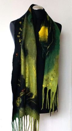 Time to shine! This high quality felted scarf was created from merino wool using hot water and soap including viscose fibers. Scarf is in black, green and yellow colors. Very soft to skin, lightweight, stylish and durable. This scarf/wrap is easy to wear all year round. Length-150 cm, width-40 cm. Hand wash only. This felted scarf CAN be MADE IN ANY SIZE AND COLOR. The process of making takes about two weeks.