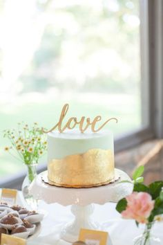 Gold leaf   mint wedding cake: http://www.stylemepretty.com/texas-weddings/driftwood-texas/2016/01/07/emerald-gold-hill-country-summer-wedding/