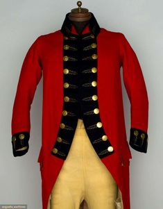 """BRITISH CONSUL'S WOOL COAT & LEATHER BREECHES, 1794 Red broadcloth cutaway coat, high stand collar, silver bullion embroidery, gold etched buttons w/ Brittania insignia, Ch 40"""", L 47""""; tan buckskin britches, fall front, below-knee length, back laces, self-covered buttons, W 32"""", Inseam 18""""; excellent. Provenance Thomas McDonnough, first British Consul to New England. Augusta Auctions"""