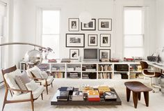 """how to make your TV decorate--not disrupt--your living room: """"go for a gallery effect Give your TV a home alongside art, with photography and paintings that surround your TV."""""""