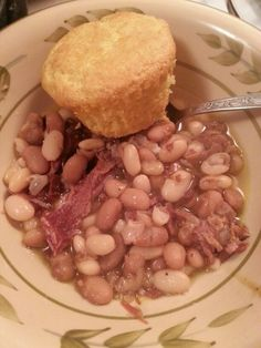 I have been cooking Ham, Northern Beans & Pinto Beans in the Crockpot all day. Little Onion Powder, Garlic Powder, Butter, Salt & Pepper to taste. Cover with water. Cook on Low 7-8 hours. Served with Cornbread Muffins on the side.