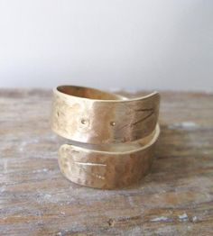 Hammered Brass Snake Ring | This wrap ring is handmade from hammered brass and stamped to ... | Rings