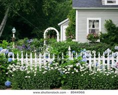 there is something very homely and happy about picket fences
