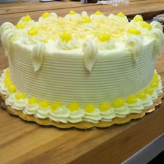 Lemon filled white cake, buttercream frosting with lemon curd accents ...