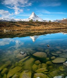 Matterhorn reflecting in Leisee Lake. by chrisburkard