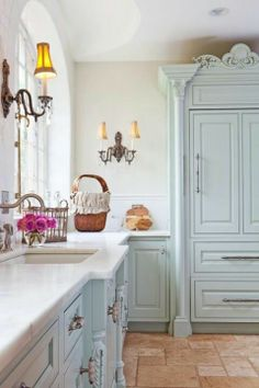 Pale blue and white kitchen.  Love the cupboards.