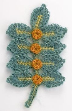 Free crochet pattern. Make this spray of leaves and berries in green and red for a Christmas motif. Add as many or as few leaves as desired. Make this super long and it's a scarf!