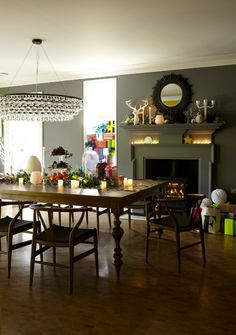 This dining room has a wonderfully festive mood thanks to the glow of candlelight. If you have pared-back, grey rooms, why not bring in colour with a stack of colourful presents? You can even just wrap boxes if you want the installation to last past the Big Day itself. Tree optional - in small spaces, it can take up too much space. Image: Livingetc