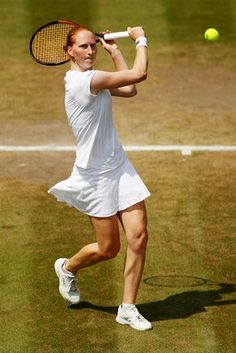 Alison Van Uytvanck of Belgium plays a backhand against Daria Kasatkina of Russia during their Ladies' Singles fourth round match on day seven of the Wimbledon Lawn Tennis Championships at All England Lawn Tennis and Croquet Club on July 9, 2018 in London, England.