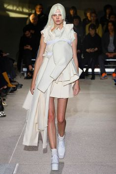Comme des Garçons [seriously, who is going to wear this garbage? i see some GREAT elements (neckline, skirt pleating) that are covered up by a load of crap. we get what you're doing, but you can still do it so we can wear it? no need to beat everyone about the head.]