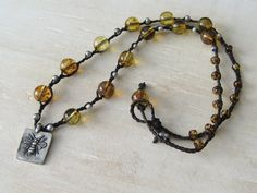 Etsy listing at https://www.etsy.com/listing/202806391/amber-and-silver-czech-glass-necklace