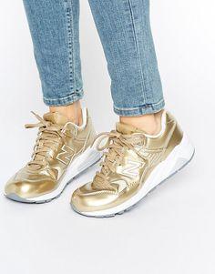 Zapatillas de deporte doradas 580 de New Balance. Zapatillas de