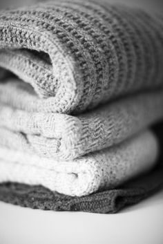 stack of sweaters or afghans/gray/cozy/winter/warm/soft