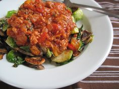 Paleo Meat Sauce.  Ingredients: ground chicken, pork sausage, peppers, onion, tomato sauce, garlic, variety of spices, s+p, fat of choice.  Put on everything :).