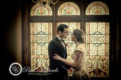 Wedding couple by stained glass windows. New Zealand #wedding #photography. PaulMichaels of Wellington http://www.paulmichaels.co.nz/