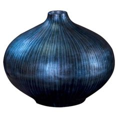 Add artful appeal to your entryway console or sideboard with this lovely wood vase, featuring an arctic blue and black finish.  Prod...