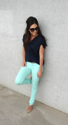 Mint skinnies with black top, leopard belt, and nude pumps