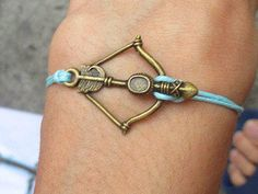 The Hunger Games inspires bow Bracelet-you can choose brass or silver from sweethearteverybody on Etsy.