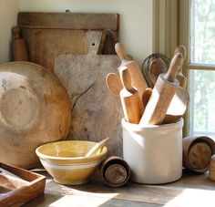 Old breadboards and rolling pins in a crock