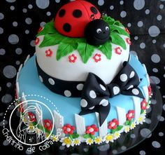 Blue and White Cake with White Picket Fence, Red Flowers, Green Leaves & White Daisies with a Lady Bug Topper