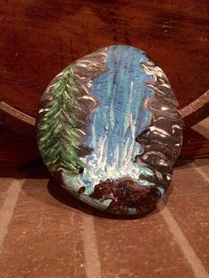 Waterfall scene painted rock by Sarasartanddesign on Etsy https://www.etsy.com/listing/254862430/waterfall-scene-painted-rock