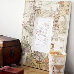 Make your own découpage picture frame...maybe not using maps, but music sheets or newpaper clippings