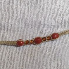 Boho orange Beaded hemp bracelet This cute bracelet is handmade with natural hemp and orange beads. Perfect for any season! This bracelet and all PeaceFrog jewelry items are made by me. PeaceFrog Jewelry Bracelets