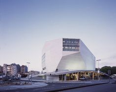 """Built by OMA in Porto, Portugal with date 2005. Images by Philippe Ruault. The past thirty years have seen frantic attempts by architects to escape the domination of the """"shoe-box"""" concert hal..."""