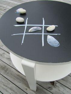 Chalkboard table.  Like the beach theme tic tac toe
