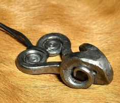 Hand forged Rams head, inspiration we have found in Celtic pottery from Serbia and Hungary. Height: 6 cm. Covered with wax, so this pendant is