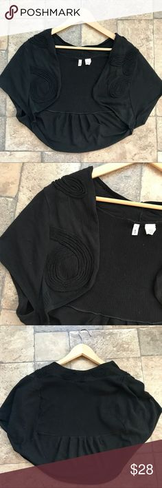 Anthropologie Moth Black Crop Cardigan/Shrug EUC Adorable Moth by Anthropologie cropped cardigan/ shrug/ bolero style sweater. It's black with gorgeous detailing around the lapel and collar. It's in EUC and ready for a new closet. It's a size small. From pet and smoke free home. Anthropologie Sweaters Cardigans