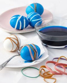 TIP: Before dyeing, place rubber bands or springtime stickers on the eggs to create the design of choice.