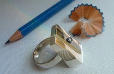 Pencil Sharpener Ring: Doodlers, artists, teachers, and students rejoice! This gorgeous ring happens to be a fully functional pencil sharpener too! It'll set you back a cool $225 but is just begging for a DIY attempt.