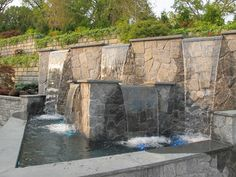 Have your Party at Anthonys Pier 9 in New Windsor, Orange County, NY. Hickory Hollow Landscapers has created three great landscapes & water feature garden ponds for your enjoyment!  The garden ponds have been created out of Pa. colonial boulders for those who love the natural look and maplebrook granite veneer for those who are more formal.  This water feature has purple petunias cascading over it.