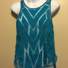 Free People teal color sleeveless parcel sheer top Front has 100% nylon mesh and 100% cotton sewn In different shapes . The back is a knitted fabric . Half open back with double row of 5 buttons down and the bottom of back lays in a small curve bottom. Free People Tops Crop Tops