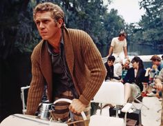 Steve McQueen is also, improbably, wearing horizontally striped pants.