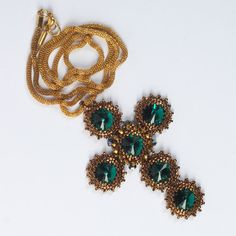Cross beadwoven emerald Swarovski pendant. Statement by Renarta