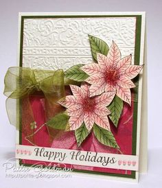 Pretty Christmas card.  use spellbinders poinsettia die here instead...