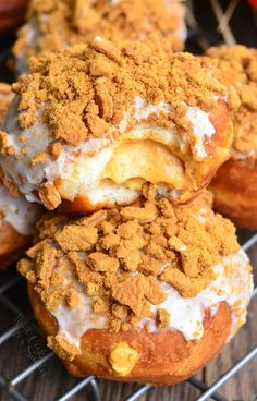 Perfect breakfast treat for the season. Easy stuffed pumpkin doughnuts filled with pumpkin cheesecake mixture and topped with pumpkin spice icing and crispy gingersnap cookies.
