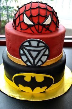 Birthday Cakes - Superhero Birthday Cake - ♥♥    A combination of chocolate and white cake with chocolate/vanilla buttercream, ganached and fondanted    Hand-cut logos of Batman, Iron Man, and a half-dome head of Spider Man (RI was used to do the webbing--SO HARD on a round surface!!) Thanks for looking :)