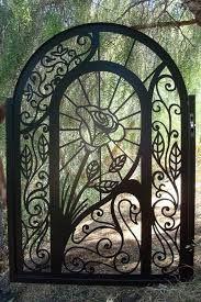 Resultado de imagen para light wood gates with wrought iron decor