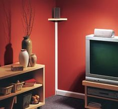 5 Easy Ways to Hide Speaker Wire - Electronic House Hide Cables, Hide Wires, Hiding Speaker Wires, Hiding Cords, Apartment Decorating On A Budget, Decorating Tips, Home Tech, Home Hacks, Creative Home