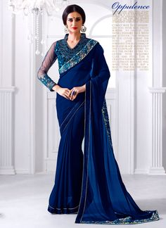 Featuring a cobalt blue georgette saree with floral embroidery and blue velvet border  It is paired with dupion silk blouse material with floral embroidery on the front,back and sleeves.This blouse can be stitched upto size 44. For stitching enquiries, please email at customercare@hunardesigns.com …