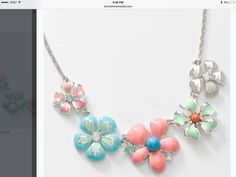 """The Flora Necklace has chrysolite opal, rosewater opal, white opal crystal, turquoise and coral crystal pearls with pastel epoxy; rhodium plating and a 16"""" to 19"""" chain."""
