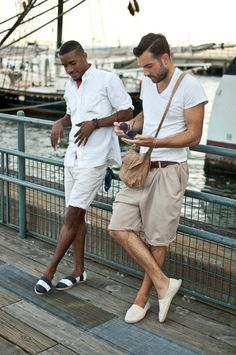simple and classic.  white v with khaki shorts and a nice canvas satchel by frankie