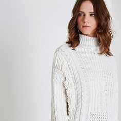 Heavyweight knit fabric Mixed stitch design Cable knit detail Fringe panels Ladder detail High neck Long sleeve Our model wears a UK 8 and is 175cm/5'9'' tall
