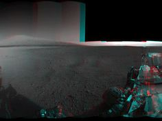 This 3-D image from NASA's Curiosity was taken from the rover's Bradbury Landing site inside Gale Crater, Mars, using the left and right eyes of its Navigation camera. Between the rover on the right, and its shadow on the left, looms the rover's eventual target: Mount Sharp. The mountain's highest peak is not visible to the rover from the landing site.